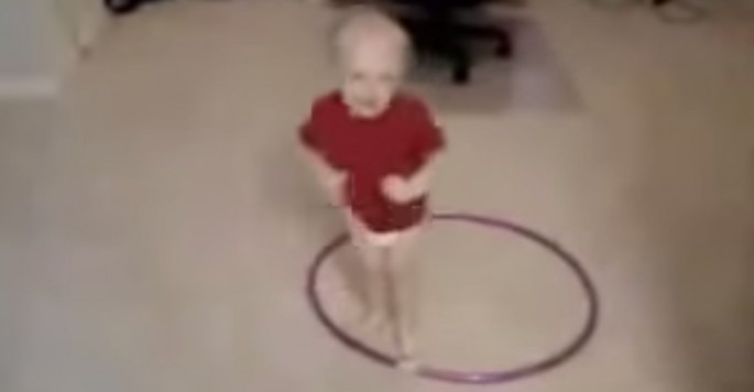 This toddler thinks he hula hoops like a boss. He's almost right, but not quite…