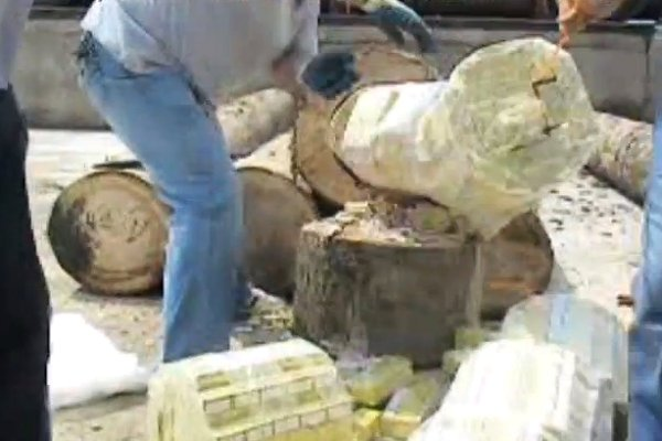 Smuggling Cigarettes in Logs (Video)