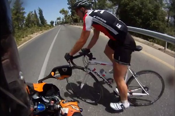 Reckless Cyclist Nearly Gets Killed by Motorcycle (Video)
