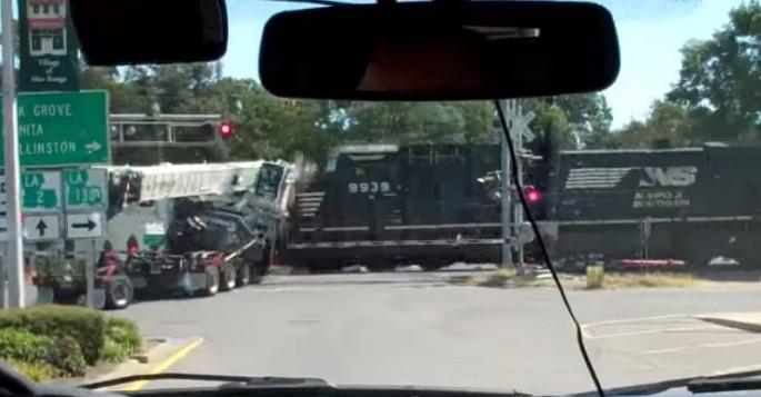 Absolutely Insane Footage of Full-speed Train Powering Through Semi Stuck on Tracks