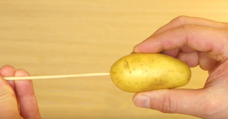 He Put A Potato On A Wooden Skewer...When He Started Cutting It, I Was SO Confused