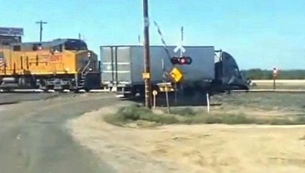 Train Hits Semi-Truck in California (Video)
