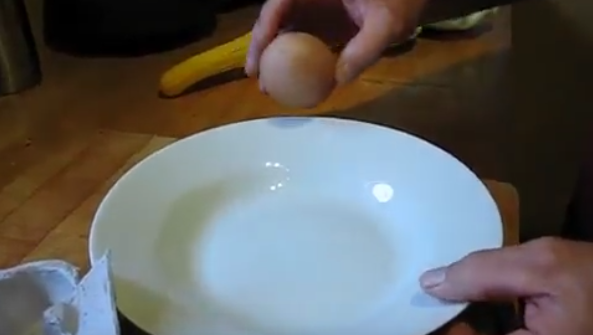 He Finds An Unusually Large Egg In The Carton. When He Cracks It? He Never Expected This To Come Out