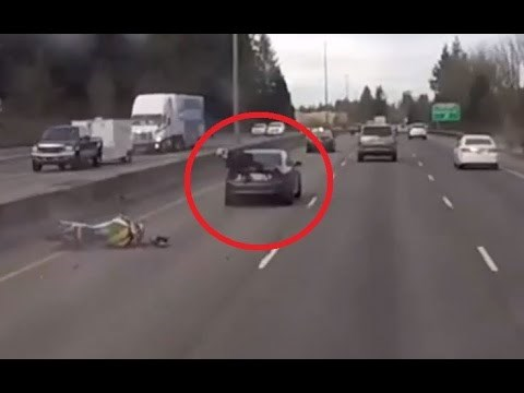 Watch Motorcycle Plow into Car on Highway, Dude Land on Trunk, Proceed to Miraculously Walk It Off