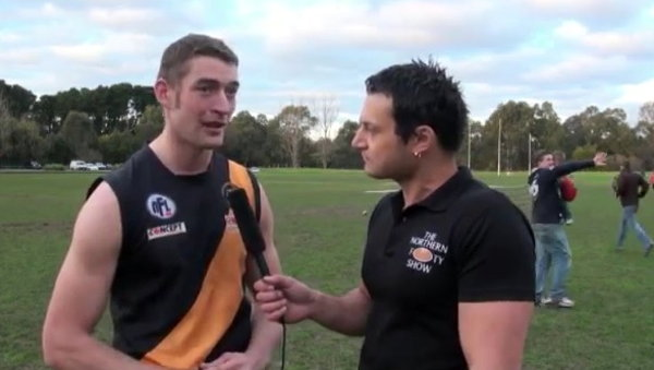 Dad Drops Kid in Background of Australian Rules Football Interview (Video)